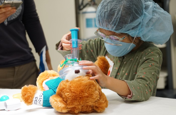 Children use medical play props to become more familiar with the treatment they will receive.